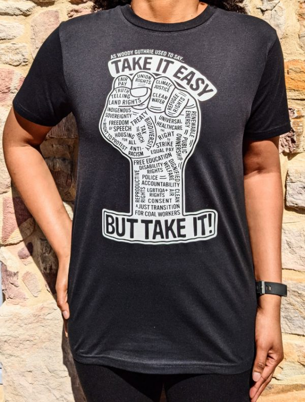 Fist take it easy design on black t-shirt worn by woman