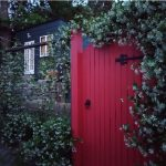 Red gate in front of studio