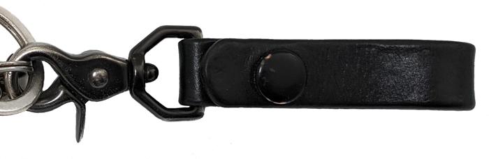 Showing wear and tear on black belt hanger