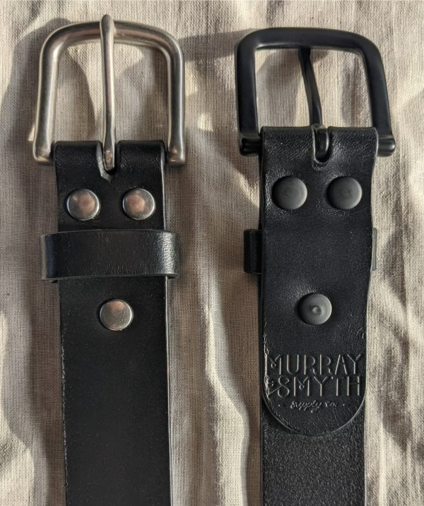 Close-up showing the hardware of two black belts