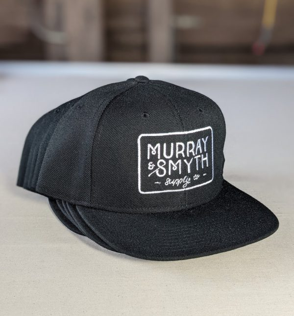 Black caps with white Murray and Smyth logo