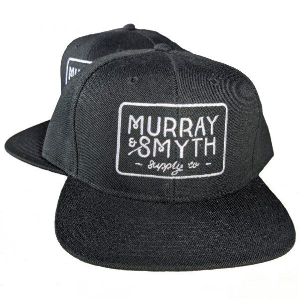 Black caps with Murray and Smyth logo